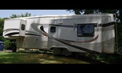 This is a 2007 DRV Luxury Suites Mobile Suites 36TK3, this unit is 36 FT in length, and has 3 slide outs. This Goose Neck fifth wheel is in like new condition with ALL THE BELLS AND WHISTLES! Some of