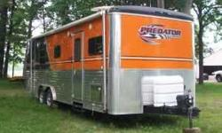 -2007 - 24' Roadmaster Predator Toy Hauler in EXCELLENT CONDITION! -Two-Tone Metal Option. Orange Front/Black Rear- Interior Color - Steel Grey- Cabinet Color. Maple- Custom Interior Trim- Black Appli