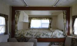 2008 Outback by Keystone travel trailer, model 21RS (22ft) with rear queen bed slide out, sleeps 8. Ducted air conditioning and heating (furnace). SAeparate bathroom with bath / shower, toilet a