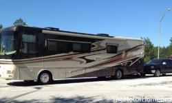Model 41DFT Bath & Half with a full-wall slide & 2 additional slide-outs. This fully loaded, luxury coach is being offered by its original owners. Built on a Roadmaster RR8R raised rail chassis and po