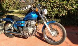 Honda 250cc Rebel with 12K miles in excellent condition. New rear tire and good front tire. Newer battery. NO scratches or corrosion. Always garaged. Excellent learner or commuter (gets 70 MPG). Lots