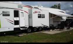 Sleeps 8 to 10 comfortably, electric bed in 10ft cargo area converts into private bedroom with full pull down screen for outside viewing.tuff ply and diamond plate also in garage area for cargo protec