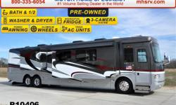 This bath & 1/2 RV is approximately 44 feet in length with a 500HP Cummins engine with side radiator Roadmaster raised rail chassis with tag axle power mirrors with heat power privacy shades Eaton Vor