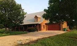 Log cabin home on .74 acre corner lot. Recent upgrades in 2011-2012. Entire exterior of home stained in 2010. Covered porch on 3 sides. Open floor plan in living area. Tile flooring in 2011. Ceiling f