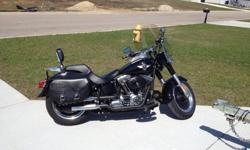 2010 Harley-Davidson Fatboy Lo, very good condition, under12k miles. Gloss black paint with silver and chrome accents on engine. $13,200.00 O.B.O Includes: windshield, saddle bags, and, backrest. Spec