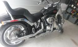 Showroom Condition Harley Davidson Softail Custom Less than 8 thousand miles and garaged kept, Always Harley Davidson Dealer serviced, Bike has Vance & Hines exhaust and have original Harley pipes als