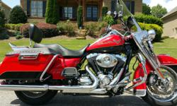This bike is just like new. Beautiful Scarlet Red & Vivid Black (2-tone $1k more) with plenty of Chrome.  If you are looking for an exceptional bike that is clean and well taken care of you have fou