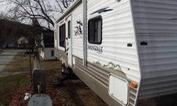 FRONT STORAGE, ELECTRIC JACKS TABLE AND BENCH AS WELL AS REAR KITCHEN!!! ORIGINAL OWNER. I have a 2010 Springdale travel trailer for sale. this unit has the rear kitchen, full slide out, 2 chairs, coa