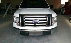 2011 Ford F-150 XL work truck,newer tires,well taking care off,very clean interior with 8 foot bed,cap with tool boxes and ladder rack,8' foot pull out heavy duty tool table,hitch.