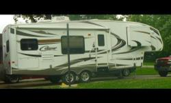 This is a 2011 Keystone Cougar 27RKS, it is 27FT in length, this unit sleeps 5 people, one owner, comes with jack stands. Fresh Water Tank, Outside Shower, Gray Water Tank, Black Water Tank, Pantry, R