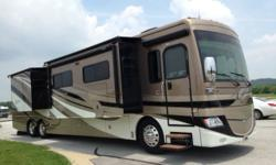 This coach has only 14,000 miles with original owners being non-smokers and no pets. Always garaged and dealer serviced. Full body slide driver side and two slides curb side. It has 1 1/2 baths with K