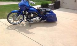 2012 Custom Street Glide with lots of extras.  All work completed at Big St. Charles Harley, Located in St. Charles, Mo.  26 Inch Renegade Wheel with matching Rear Wheel, Air Cleaner and Matching Rot