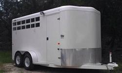 This horse trailer is 7 feet tall and 6 foot 9 inches wide. The front tack is sealed and loaded with features. It has an aluminum roof all one piece with aluminum fenders and steel frame. The tack roo