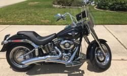 2013 Harley Davidson FATboy. Ride with badlands solo saddle or fully convertible with detachable windshield, dual saddle and detachable backrest. 2 into 1 exhaust, Over 20k invested in after market pr