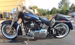 Make: Harley Davidson Condition: Used Blue Pearl PaintWhite Sidewall tires103 CI V TwinWindshieldSmall Paint chip on right side of tank Light scratches on left side of the tank in clear coat Spokes ne