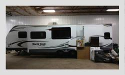 Length: 35 feet Year: 2013 Make: Heartland RV Model: North Trail 31QBSS Caliber Miles: NA Interior Color: Earth tones Exterior Color: White Slides: 0 Super clean 2013 Hearthland NorthTrail Caliber Edi