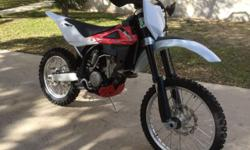 This a clean one owner clear, blue Texas tittle. The bike was purchased new, I do not know the Hrs on it. It has relatively new chain and sprockets 3-6 hrs of riding on them. has radiator guards. Reas