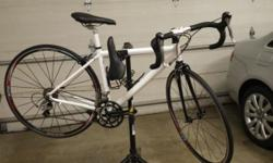 Like brand new (ridden 3 times) 2013 Nashbar Women's Bicycle, model WR2 all White - SHARP! 44cm (for petite women). Has very nice Shimano 105 components with carbon fork and aluminum frame. Women's co