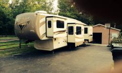 **Currently located at Encore RV Park in FL** For sale is this 2014 CEDAR CREEK fifth wheel by FOREST RIVER, 38FL (Front Living Room) with 5 slides. This fifth wheel has only been used approximately 5