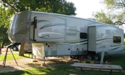 This 2014 Forest River Silverback 29RE is ready to make your traveling dreams come true. It is 33.7 feet in length and features a charming layout design that has three slide-outs and will sleep four p