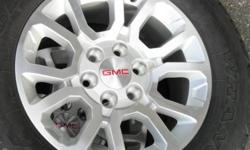 new 2014 GMC Sierra / Yukon wheels & tires to fit the (88) 99- 2014 trucks & SUVs. Will also fit the GM Chevy, but these have the gmc center caps.   Covered lug nuts & tpms available but not included.
