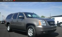 This 2014 GMC Yukon XL SLT, Stock # 15538 has a charcoal exterior, with a gray leather interior and has 39,677 miles. This GMC Yukon XL Includes a worry-free AutoCheck vehicle history report so you kn