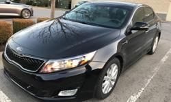 We are excited to offer this 2014 Kia Optima. This 2014 Kia Optima comes with a CARFAX Buyback Guarantee, which means you can buy with certainty. This wonderfully fuel-efficient vehicle offers a suppl