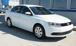 Artificial Leather. Smart switchgear. Relaxation made easy. This 2014 Jetta is for Volkswagen lovers looking all around for that perfect, fuel-efficient car. Tackles rough pavement with grace. It is n