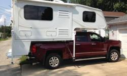 Stock Number: 723750. THIS IS A TRAVEL LITE CAMPER FOR SALE (only) Self contained unit with dining area and slide-out. Equipped with , Cummins Onan Generated 6 cu. ft. Dometic refridgerator/freezer, ,