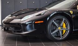 Lamborghini Houston is proud to offer this beautiful 2015 Ferrari 458 Italia Spider in Nero over a Crema Interior with 6,874 miles. Original M.S.R.P. $318,915. The 458 Italia Spider is powered by a 4.
