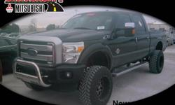 **UNIVERSITY MITSUBISHI** 2015 Ford F-250 Platinum with a Lift and Offroad Wheels/Tires, GVWR: 10,000 lb Payload Package, 4WD, ABS brakes, Compass, Electronic Stability Control, Front dual zone A/C, H
