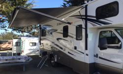 THIS MODEL 2501TS IS DECKED OUT AS A TOP OF THE LINE MODEL BUILT AND BACKED BY BERKSHIRE-HATHERWAY. SAHARA INTERIOR W/ CHERRY WOOD CABINETS. PURCHASED NEW FROM CAMPING WORLD, MERIDIAN IDAHO AND REGIST