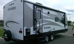 2015 Keystone Laredo 240MK, Glacier Package. Resist All premium paint and fabric protection. Slide out. Sleeps 4, dinette fold out, Large shower, flat screen TV, electric front jack and awning . Cover included. New condition. M.S.R.P $32.300 - See more