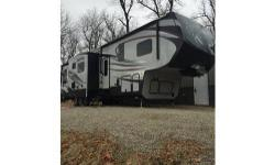Original Owner, Factory/Extended Warranty, Non-Smoking, No Pets, Cold Weather Package, Platinum Package. INTERIOR FEATURES: Vinyl Floors, Carpet, Maple Cabinets, Full Kitchen, Side by Side Fridge, Mic