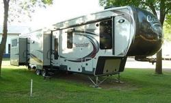 Get ready to make your traveling dreams come true in this 2015 Palomino Columbus 385BH. This fifth wheel has been beautifully maintained. It features a charming layout design that is 41 feet in length and has five slide-outs and one awning. This unit will