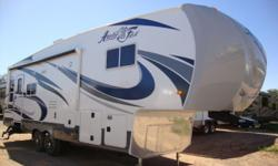 Silver Fox Edition 29-5T 5th Wheel by Arctic Fox . A true 4 season coach, built to withstand all climates. Even sub zero weather. Heated enclosed holding tanks and Superior insulation and construction