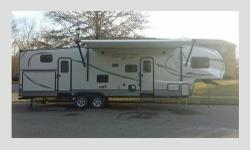 For sale is my 2016 5th wheel camper with bunkhouse and 1 and a half baths. This camper has a full sized kitchen and an outside mini kitchen. It has a master bed and bath with a queen sized bed, priva