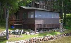 Honeymooners delight!! Fall in love all over again every time you come back to the cabin. One the East shore of Big Sand Lake sets this charming 2 bedroom cabin. Fishing-water sports-All from this spo