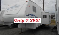 GREAT FINANCING AVAILABLE WITH APPROVED CREDIT! We also accept trade-ins, do lay-away sales and accept credit cards. This is a very nice 5th wheel, ready for travel and camping. It is a 2002 27' Scout