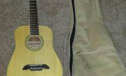 I have for sale a 3/4 size acoustic guitar made by Alvarez. It comes with a tan case, with backpack-style straps and a zipper pouch in the front to carry any books or sheet music. This guitar is part