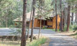 Enjoy wide-open Swan Mountain views from this bright and spacious home on an oversized Ponderosa Estates lot. Recently remodeled kitchen features granite countertops, Sub Zero fridge, and other high-e
