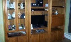 "I believe its a Broyhill . 3 piece oak entertainment center. Includes curio cabinet, TV cabinet, and liquor storage cabinet. All have built in lighting and cabinets underneath . Each unit is 33"" wide,"