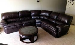 3 piece sectional leather sofa:+ purchased 2 years back, fully intact and new condition.+ originally purchased for $3000.+ dark brown finish.+ leather sofa.+ 2 recliners chairs on one section.+ pull o
