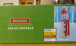 """Very beautiful 30"""" indoor/outdoor LED light snowman. With original box. ONLY $10  If interested call 517-580-3293  Or stop by 700 East Kalamazoo St, Lansing 48912  Aprils Antiques and Home Furnishings"""