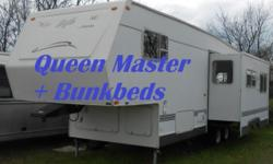 For sale is an extra nice 2002 30' Jayco Eagle 5th wheel with rear bunk bedroom. The trailer is in perfect mechanical condition and has always been non smoking and no pets. The rear bedroom has an ove