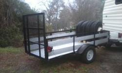 everything replaced , all wood and paint , large drop gate .$500.00 for trailer good for landscaping , 4 wheelers or whatever , thanks 864-844-0886 e-mail or text or call is fine thanks tires you see