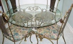 Unique 42 inch heavy glass top table with 4 chairs and 1 matching bar stool. Table and chairs are heavy steel constructed with bamboo backs and cousin seats. Please phone or text 731-four9nine-Zero2th