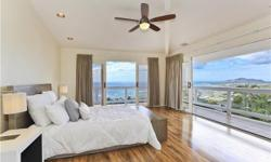 This beautiful home on the rarely available lower-section of Hawaii Loa Ridge features sweeping ocean views from the master & living area, a large master suite, kitchen, main living area and garage al