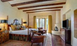 This elegant 3530 square foot, pueblo style home of rastra construction, was built by renowned Santa Fe builder Sharon Woods. The home is situated in the heart of Las Campanas in the highly desired Cl