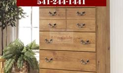 This high cabinet has a really welcoming appearance with replicated pine grain and metal handles. Brings a nation want to your bed room. We have this IN STOCK and ready for you to take house today! GR